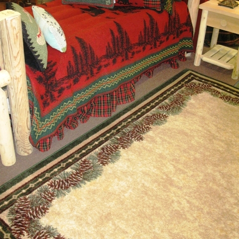 Bedroom scene with Pine Mountain floor rug Wooded river Red BEar Bedding.